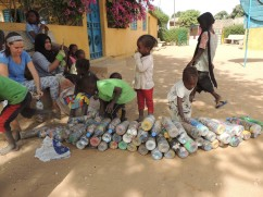 Students at École Natangué helping to sort the bottles used as EcoBricks.
